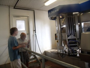 (Lancelot discussing Robotic Milking with Dick Waybright at the Mason Dixion Dairy.)