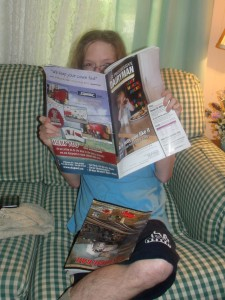 "Lancelot reading June, 2013 issue of ""Progressive Dairyman""."