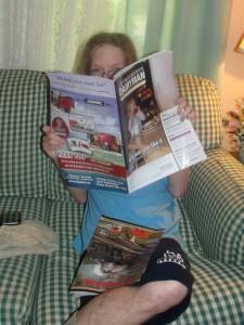 "Lancelot reading June, 2013 issue of ""Progressive Dairyman""."